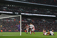 Ryan Shawcross of Stoke City (2R) scores an own goal for Tottenham's first goal. Premier league match, Tottenham Hotspur v Stoke City at Wembley Stadium in London on Saturday 9th December 2017.<br /> pic by Steffan Bowen, Andrew Orchard sports photography.