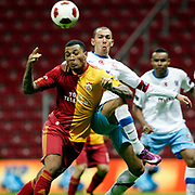 Galatasaray's Colin Kazim RICHARDS (L) and Trabzonspor's Umut BULUT (C) during their Turkish superleague soccer derby match Galatasaray between Trabzonspor at the TT Arena in Istanbul Turkey on Sunday, 10 April 2011. Photo by TURKPIX