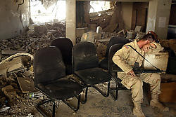 A soldier is seen resting inside the lobby of the Canal Hotel after it was bombed, in Baghdad, Iraq on Aug. 21, 2003.