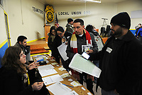 Volunteers check out with materials they need for the 2017 Point-In-Time Homeless Count and Survey conducted by the Coalition of Homeless Service Providers in Salinas early Wednesday morning, Jan. 25th.