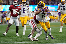 Justin Jefferson #2 of the LSU Tigers reaches for a touchdown during the first half against the Oklahoma Sooners in the 2019 College Football Playoff Semifinal at the Chick-fil-A Peach Bowl on Saturday, Dec. 28, in Atlanta. (Paul Abell via Abell Images for the Chick-fil-A Peach Bowl)