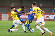 AFC Wimbledon attacker Zach Robinson (14) battles with Brighton and Hove Albion defender Antef Tsoungui (71) during the EFL Trophy Southern Group G match between AFC Wimbledon and Brighton and Hove Albion U21 at The People's Pension Stadium, Crawley, England on 22 September 2020.