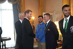 The Duke of Sussex meets Australia cricket captain Aaron Finch (centre), Afghanistan captain Gulbadin Naib (left) and Bangladesh captain Masrafe Bin Mortaza (right). The captains of the teams taking part in the ICC Cricket World Cup meet for a photograph in the 1844 Room at Buckingham Palace in London, ahead of the competition's Opening Party on the Mall.
