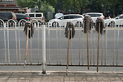 Mops drying on fence