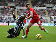 Moussa Sissoko of Newcastle United claims for a penalty as he is brought down by Joe Allen of Liverpool - Barclays Premier League - Newcastle Utd vs Liverpool - St James' Park Stadium - Newcastle Upon Tyne - England - 1st November 2014  - Picture Simon Bellis/Sportimage