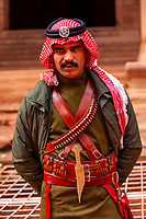 A Bedouin Desert Patrol policeman at the Treasury monument (Al-Khazneh), Petra archaeological site (a UNESCO World Heritage site), Jordan.