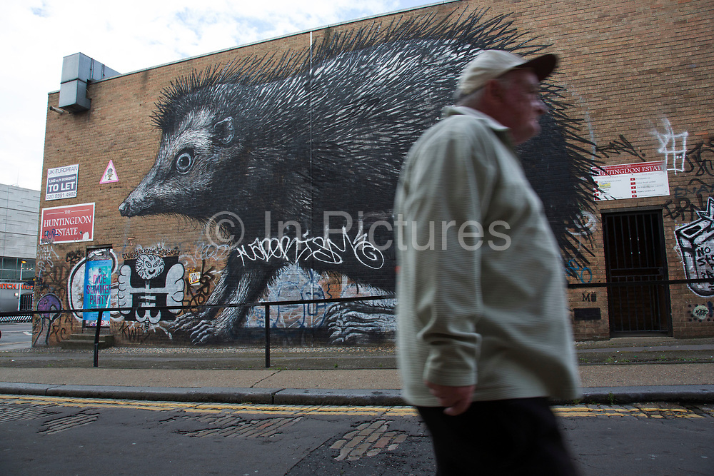 Street art hedgehog by Roa in the Brick Lane area of Shoreditch, East London, United Kingdom. Street art in the East End of London is an ever changing visual enigma, as the artworks constantly change, as councils clean some walls or new works go up in place of others. While some consider this vandalism or graffiti, these artworks are very popular among local people and visitors alike, as a sense of poignancy remains in the work, many of which have subtle messages. (photo by Mike Kemp/In Pictures via Getty Images)
