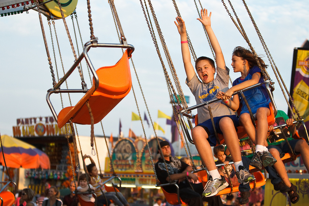 Jon Beck, 12, and Megan Beck, 10, of Kearney enjoy one of the rides in the midway at Nebraska State Fair in Grand Island.