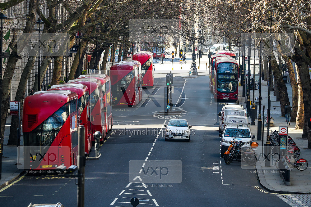 A general view of London Red Buses gathering from the Golden Jubilee Bridge looking towards nearly empty Trafalgar Square, Wednesday, March 25, 2020. British lawmakers voted to shut down Parliament for 4 weeks, due to the coronavirus outbreak. The new coronavirus causes mild or moderate symptoms for most people, but for some, especially older adults and people with existing health problems, it can cause more severe illness or death. (Photo/Vudi Xhymshiti)