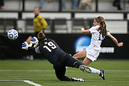 04 December 2011: Duke's Molly Lester (15) beats Stanford's Emily Oliver (19), buts put the ball over the goal. The Stanford University Cardinal played the Duke University Blue Devils at KSU Soccer Stadium in Kennesaw, Georgia in the NCAA Division I Women's Soccer College Cup Final.