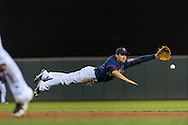 Brian Dozier #2 of the Minnesota Twins attempts to make a diving play during a game against the Chicago White Sox on May 13, 2013 at Target Field in Minneapolis, Minnesota.  The Twins defeated the White Sox 10 to 3.  Photo: Ben Krause