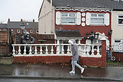 Gorilla in housing estate. A staunch unionist area. Shankhill Road estate, Belfast. It is a staunch unionist area, fiercely pro-Britain. Their representatives, the Democratic Unionist Party, founded by Ian Paisley in 1971, are presently in parliament in collusion with the conservative party, looking for a hard Brexit with a border between Northern Ireland and the South. The ten DUP votes gives the conservative party its majority in government. This is nothing new. During the 'Troubles' three decades of bloodshed, with Catholic Irish Republican Nationalists seeking to unit Ireland, the pro-British Protestant loyalists wanted to remain part of the United Kingdom