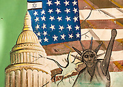 IRAN vs USA Love and Hate<br /> <br /> The United States and Iran have resumed their talks on a nuclear deal and the lifting of the embargo. But in the streets of Iran, there is still a lot of propaganda against the Americans, showing Obama as a traitor and U.S. Marines as murderers. At the same time, Iranian people increasingly appear to be adopting an American way of life, using iPhones, eating in fake KFCs, drinking Pepsi, and wearing Nike shoes.<br /> <br /> PHOTO SHOWS:    This combination of the Israeli and American flags together with symbols of the United States used to be on the walls of the former American embassy in Tehran. They were erased in 2015 when Iran resumed talks with the United States.<br /> ©eric lafforgue/Exclusivepix Media