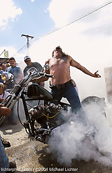"""Nick's Ecstasy. Sundance. WY. 2002<br /> <br /> Limited Edition Print from an edition of 50. Photo ©2002 Michael Lichter.<br /> <br /> The Story:""""I feel like Satan coming out from the depths of hell, coming through the smoke.""""  Nick Fredella, on doing a burn-out."""