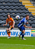 Hull City's George Honeyman crosses the ball despite the attentions of Bristol Rovers' Max Ehmer<br /> <br /> Photographer Lee Parker/CameraSport<br /> <br /> The EFL Sky Bet League One - Hull City v Bristol Rovers - Saturday 6th March 2021 - KCOM Stadium - Kingston upon Hull<br /> <br /> World Copyright © 2021 CameraSport. All rights reserved. 43 Linden Ave. Countesthorpe. Leicester. England. LE8 5PG - Tel: +44 (0) 116 277 4147 - admin@camerasport.com - www.camerasport.com