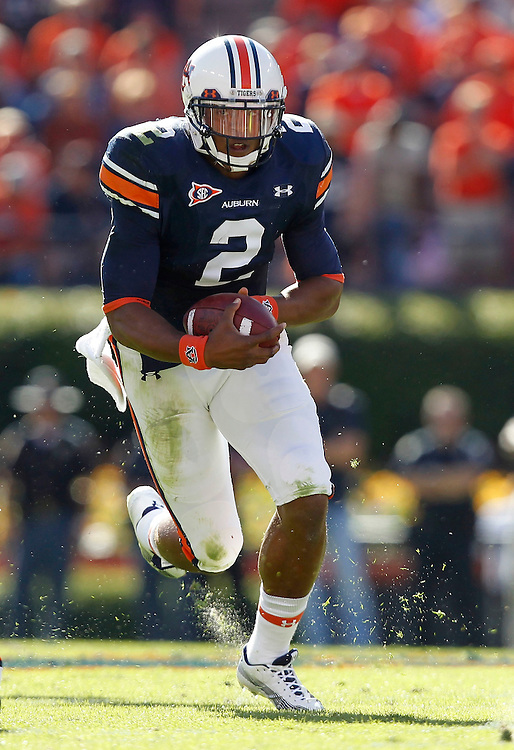 AUBURN - OCTOBER 16:  Quarterback Cam Newton #2 of the Auburn Tigers runs with the ball during the game against the Arkansas Razorbacks at Jordan-Hare Stadium on October 16, 2010 in Auburn, Alabama.  (Photo by Mike Zarrilli/Getty Images)