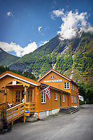 A yellow building against a scenic backdrop in Flam, Norway