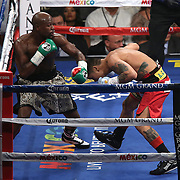 LAS VEGAS, NV - SEPTEMBER 13: Floyd Mayweather Jr. (L) punches a leaning Marcos Maidana during their WBC/WBA welterweight title fight at the MGM Grand Garden Arena on September 13, 2014 in Las Vegas, Nevada. (Photo by Alex Menendez/Getty Images) *** Local Caption *** Floyd Mayweather Jr; Marcos Maidana