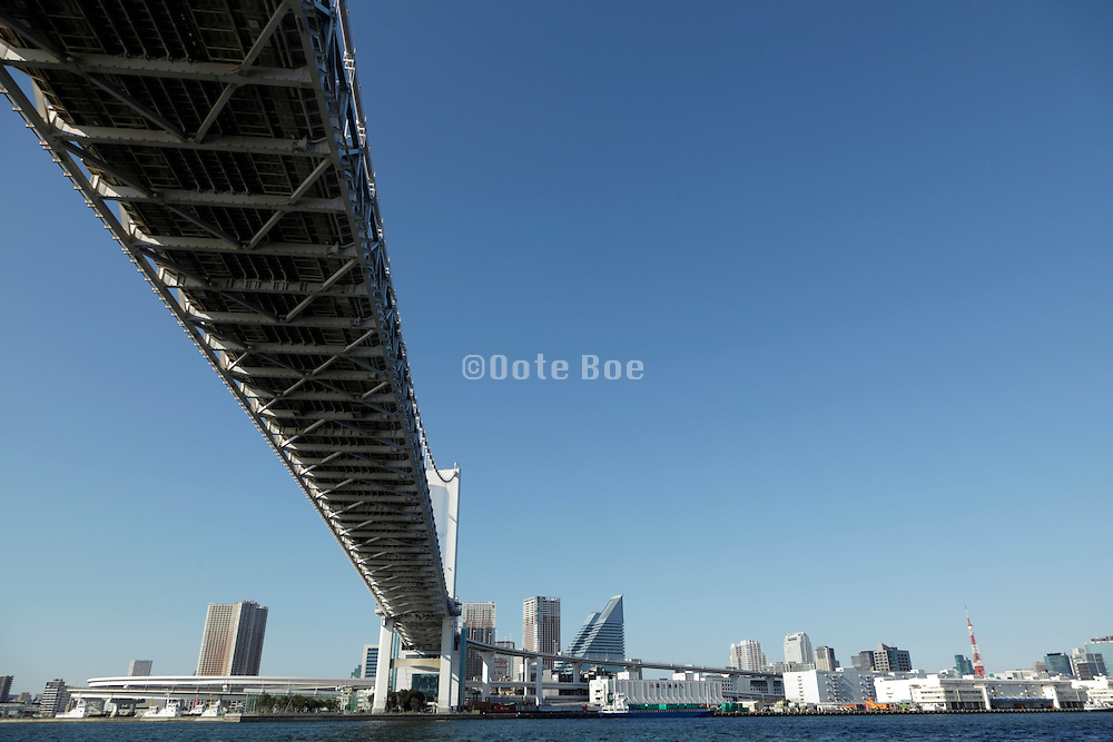 the Rainbow Bridge with the Odaiba district in Tokyo seen from the water Tokyo Japan