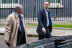 London, UK. 7 May, 2019. Matt Hancock MP, Secretary of State for Health and Social Care, and Geoffrey Cox QC MP, Attorney General, leave 10 Downing Street following a Cabinet meeting.