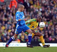 Fotball<br /> Photo: Daniel Hambury, Digitalsport<br /> NORWAY ONLY<br /> Norwich City V Wigan Athletic<br /> Nationwide League  Division One. <br /> 9/04/2004.  <br /> <br /> Norwich City's Damien Francis battles with Wigan Athletic's Jason Jarrett
