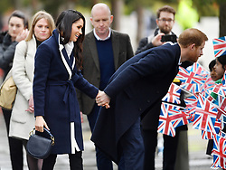 2 in series of 10. File photo dated 8/3/2018 of Prince Harry and Meghan Markle holding hands as they meet members of the public on a walkabout during a visit to Millennium Point in Birmingham.