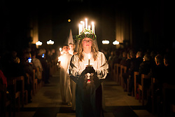 © Licensed to London News Pictures. 09/12/2016. York UK. 15 year old Matilda Jarl from Stockholm leads the Sankta Lucia festival of Lights procession at York Minster last night (friday 09th Dec) In Sweden, Lucia is one of the most significant traditions in the calendar,  a powerful symbol and celebration of light and an integral part of the Advent season. The celebration of Sankta Lucia is based on the bravery and martyrdom of a young Sicilian girl - St Lucy who died in the early fourth century. Her name and story reached Sweden along with Christianity, and she remained popular even after the Reformation as the bringer of light during the long darkness of winter. Photo credit: Andrew McCaren/LNP