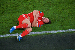 CARDIFF, WALES - Friday, September 6, 2019: Wales' Connor Roberts lies injured during the UEFA Euro 2020 Qualifying Group E match between Wales and Azerbaijan at the Cardiff City Stadium. (Pic by Paul Greenwood/Propaganda)