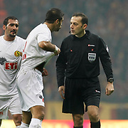 Referee's Cuneyt CAKIR (R) during their Turkish Super League soccer match Galatasaray between Eskisehirspor at the Turk Telekom Arena at Seyrantepe in Istanbul Turkey on Sunday, 06 February 2011. Photo by TURKPIX