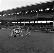 27/03/1966<br /> 03/27/1966<br /> 27 March 1966<br /> National Hurling League, Division II: Antrim v Kerry at Croke Park, Dublin. <br /> Antrim's W. McDonnell (left) and Kerry's B. Campbell tussel for the ball ; while, to the right, E. O'Sullivan (Kerry) and J. O'Reilly (Antrim) await the outcome.