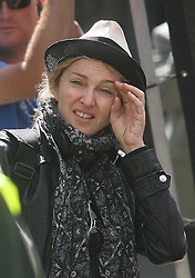 ©London News Pictures. 15/01/2011 .Picture Credit Should read Neil Hall/London News Pictures.Madonna directs her new period film W.E. starring Abbie Cornish about the abdication of King Edward in London on 08/08/2010. Madonna strains as she is on set