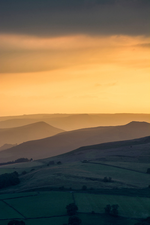 Sun setting over the Peak District National Park, England.