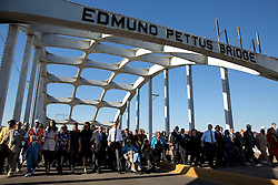 President Barack Obama, First Lady Michelle Obama and the First Family are joined by former President George W. Bush, former First Lady Laura Bush, Rep. John Lewis, D-Ga., former foot soldiers and other dignitaries in marching across the Edmund Pettus Bridge to commemorate the 50th Anniversary of Bloody Sunday and the Selma to Montgomery civil rights marches, at the Edmund Pettus Bridge in Selma, Ala., March 7, 2015. (Official White House Photo by Pete Souza)<br /> <br /> This official White House photograph is being made available only for publication by news organizations and/or for personal use printing by the subject(s) of the photograph. The photograph may not be manipulated in any way and may not be used in commercial or political materials, advertisements, emails, products, promotions that in any way suggests approval or endorsement of the President, the First Family, or the White House.