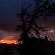 Intense late afternoon thunderstorms give way to a colorful post sunset at Minaret Vista looking out over the Eastern Sierra mountain range.