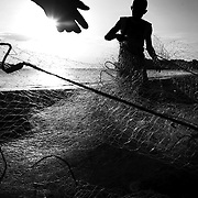Fishermen organize their nets on the beach of Santa Catalina, Panama. The numbers of sea-life in the nearby waters have drastically declined in the last ten years. Overfishing is of great concern worldwide as fish numbers around the globe continue to plummet. Many species of fish are diminishing in numbers as a result of pollution and overfishing. Sea-life worldwide is being drastically effected by these and other forms of human intrusion.