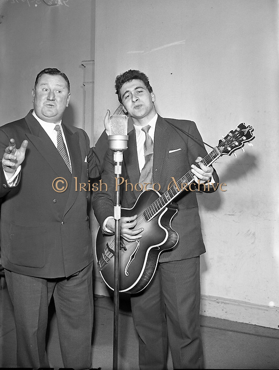 """Willie Brady (with guitar) in Take the Floor.11/04/1957..1950s and 60s Willie Brady had been a recording artist for Avoca Records in the U.S.A. and Ireland, was one of the first Irish artists to revive and popularize the singing of Irish songs and ballads at this time. He was frequently to be heard on Radio Eireann..Din Joe or Denis Fitzgibbon a comedian and compere of RTE's """"Take the Floor"""""""