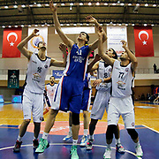 Istanbul BSB's Dusan Cantekin (L) Burak Erol (R) and Anadolu Efes's Emircan Kosut (C) during their Turkish Basketball League match Istanbul BSB between Anadolu Efes at Cebeci Arena in Istanbul Turkey on Monday 09 March 2015. Photo by Aykut AKICI/TURKPIX