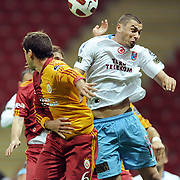 Trabzonspor's Burak YILMAZ (R) during their Turkish superleague soccer derby match Galatasaray between Trabzonspor at the TT Arena in Istanbul Turkey on Sunday, 10 April 2011. Photo by TURKPIX