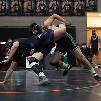 Farmington Scorpion Xander Vincent wrestles Miyamura Patriot Dominic Gutierrez Saturday at Gallup High School in Gallup at the Duel in the Dunes wrestling tournament.