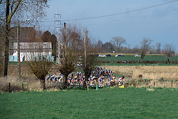 Weaving through the Flandrian countryside the peloton is lead by Christine Majerus - Women's Ronde van Vlaanderen 2016. A 141km road race starting and finishing in Oudenaarde, Belgium on April 3rd 2016.
