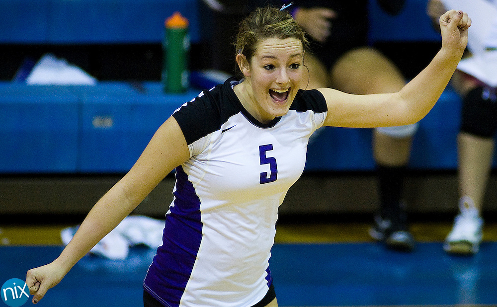 Cox MIll's Emily Stevens celebrates a point against Mount Plesant during South Piedmont Conference volleyball action Thursday night at Mount Pleasant High School. (Photo by James Nix)