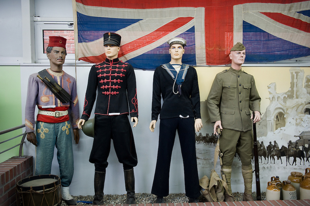 Mannequins dressed with British, American, Moroccan and french uniforms of WWI under the Union Jack at the the Somme Trench Museum in Albert (Musée Somme 1916)The museum is in the old crypts under the basilica of Albert and shows scenes of trench life from WWI, original uniforms, war paraphernalia  and other items rescued from the fields.