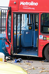 Ladbroke Grove, London, November 17th 2016. A double decker bus crashes into Kensal House on Ladbroke Grove prompting a major response from the emergency services including the air ambulance. According to Detective Chief Superintendent Ellie O'Connor of Met Police Kensington and Chelsea, 14 people including the driver were hurt, with none sustaining life-threatening or life changing injuries. Police officers would not speculate on the cause of the accident, but apologised for delays and commended all branches of the emergency services for their prompt and efficient response. The bus will be towed away for further investigations. PICTURED: The windscreen of the bus hangs from its mountings.