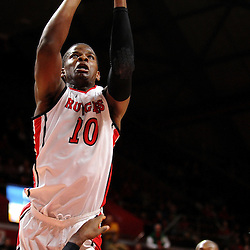 Junior Etou #10 of the Rutgers Scarlet Knights scores a layup over Anthony Lee #3 of the Temple Owls during the second half of Rutgers men's basketball vs Temple Owls in American Athletic Conference play on Jan. 1, 2014 at Rutgers Louis Brown Athletic Center in Piscataway, New Jersey.