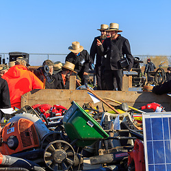 Gordonville, PA, USA / March 10, 2018: Local members of the Amish Community serve as auctioneers at the annual Lancaster County Mud Sale at the Gordonville Fire Company.
