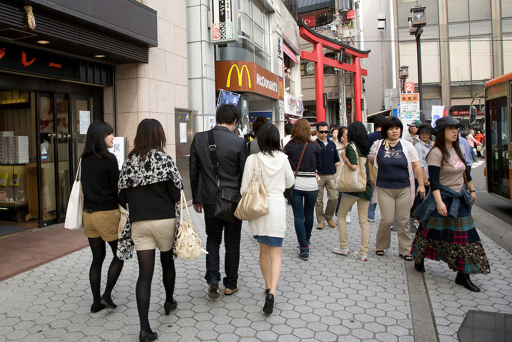 Asia, Japan, Honshu island, Kanagawa Prefecture, Kamakura, people on busy street with McDonalds and giant Torii gate