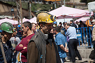 Rescue workers at the Soma coal mine return from a shift in the shaft. Three days after the fatal explosion, many workers have yet to be found.
