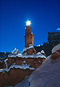 Sun backlighting Claron Formation hoodoo on Peek-a-boo Trail, Bryce Canyon National Park, Utah.
