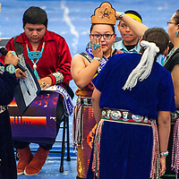 111513       Cable Hoover<br /> <br /> Samantha Vandever wipes her eyes as she is crowned Miyamura High School Princess during the first-ever Native pageant at Miyamura High School Friday. Lathan Halloway, background, was also named as Miyamura High School Brave.