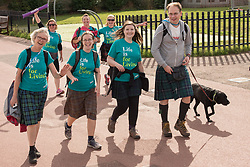 The Edinburgh Kiltwalk passed along Portobello Prom this lunchtime. Amongst the walkers, raising funds for a wide range of charities, were Portobello's four councillors, walking together in their fundraising efforts for the Thistle Foundation.  Calum Laidlaw started the 24-mile Mighty Stride in Holyrood Park while the other three councillors - Maureen Child, Mary Campbell and Kate Campbell started the 15.5-mile Big Stroll in Musselburgh. Pictured Maureen Child, Mary Campbell, Kate Campbell.<br /> © Jon Davey/ EEm